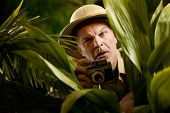 Explorer Photographer Hiding In Vegetation