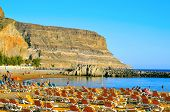 PUERTO MOGAN, SPAIN - OCTOBER 14: View of Puerto Mogan beach on October 14, 2013 in Gran Canaria, Canary Islands, Spain. This is an important winter tourist destination for many europeans