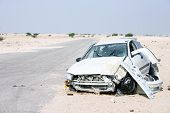 The wreckage of a car in the desert of central Qatar in 2003, apparently the result of a driver losi