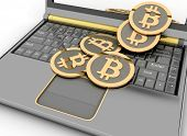 Bitcoins on laptop. Conception of electronic earnings.