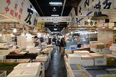 Tokyo - Nov 26: Seafood Vendors At The Tsukiji Wholesale Seafood And Fish Market In Tokyo