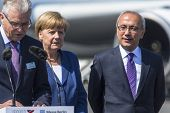 BERLIN, GERMANY - MAY 20, 2014: German Chancellor Angela Merkel (C) and Turkish Minister of transpor