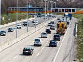 cars on a highway with a speed limit icon photos of transport, mobility, environmental protection