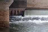 Waterfall Under The City Bridge