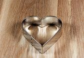 Heart Shape Cookie Mold On Wooden Surface