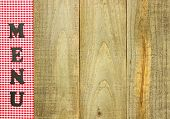 Menu sign with red checkered left border on rustic wooden background