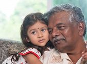 Portrait Indian family at home. Grandparent and grandchild close up face. Asian people living lifest