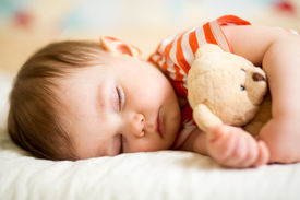 picture of infant  - infant baby boy sleeping with plush toy - JPG