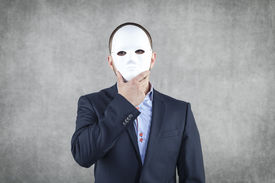 stock photo of incognito  - Business man Hidden Behind The Mask - JPG