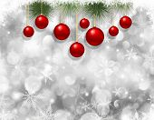 Decorative Christmas background with hanging baubles on a snowflake background