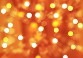 Abstract festive background, orange blurry backdrop, many defocused glowing light, Christmas time greeting card, New Year celebration concept