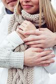 Close-up couple embracing in woolen sweaters