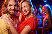 Portrait of couple having good time at nightclub