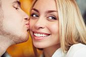 Close-up of happy woman being kissed