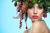 Christmas Woman. Beautiful New Year and Christmas Tree Holiday Hairstyle and Make up.