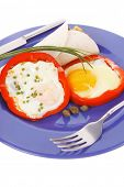 fried eggs and tortilla with salad served on blue plate with cutlery isolated over white background
