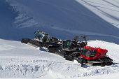SOCHI, RUSSIA - MARCH 22, 2014: Ratraks, grooming machines, special snow vehicles in ski resort.