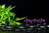 Spa Concept Of Zen Basalt Stones With Drops, Lilac Candles, Beads And Bamboo, Closeup