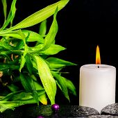 Spa Setting Of Zen Basalt Stones With Drops, White Candle, Bead And Bamboo, Closeup