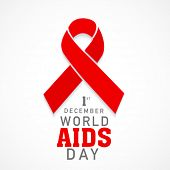 1st December World Aids Day concept with text and red ribbon of aids awareness.
