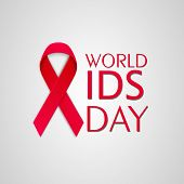 World Aids Day concept with red ribbon of aids awareness on shiny grey background.