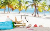 Champagne flutes on sunny beach, celebration theme.