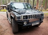 Black Hummer H2 Vehicle Stands On Dirty Country Road