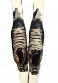 Old Ski Boots Isolated On White Background.