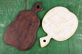 Empty cutting boards on wooden background