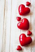 Red hearts on the vintage wooden background