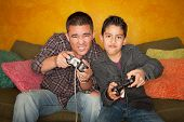 Hispanic Man And Boy Playing Video Game poster