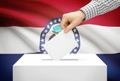 Voting Concept - Ballot Box With National Flag On Background - Missouri