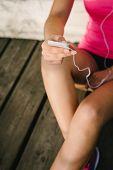 Female Athlete Messagin On Smartphone