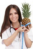 Nutritionist Doctor Measuring a Pineapple Fruit
