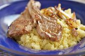 Roasted lamb cutlets with couscous and onion