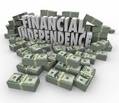 Financial Independence 3d words in piles of cash, money, earnings, income, revenue and profits to illustrate increasing your wealth and security