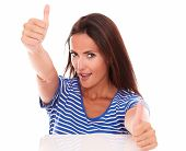 Cheerful Female In Blue T-shirt With Thumbs Up