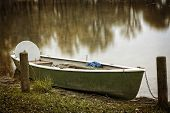 Empty rowboat on lake Chiemsee, Bavaria, in autumn
