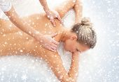 Beautiful and healthy woman in spa. Massage and healing. Winter concept.