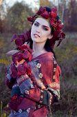 foto of pixie  - beautiful brunette in autumn red leaves looking like pixie - JPG