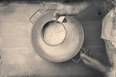 pic of flour sifter  - Closeup photo of a chef lady sifting flour for kneading - JPG