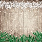 Fir Tree Branches And Snowflakes On The Wooden Board.