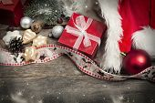 Christmas decorations and home made ginger bread on rustic wooden background