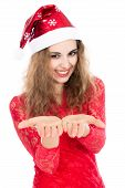 Beautiful Young Woman In Santa Claus Hat Looking At Open Hands