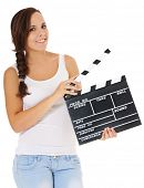 Young woman holding clapperboard. All on white background.