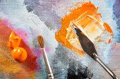 Professional acrylics paints with artistic putty knife and brush on canvas