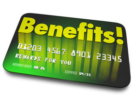 stock photo of loyalty  - Benefits word on a green credit card to illustrate shopper loyalty points earned by using the card in a rewards program to encourage more purchases or buying - JPG