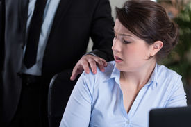 image of inappropriate  - Young attractive woman and workplace harassment - JPG
