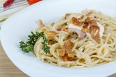 stock photo of carbonara  - Pasta carbonara with sauce and bacon served thyme - JPG