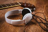 stock photo of bluegrass  - acoustic guitar and headphone on fabric sofa  - JPG
